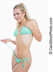 Sexy woman in green bikini