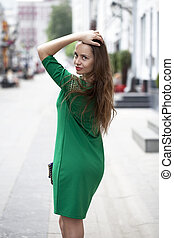 Sexy woman in green dress on the street