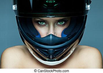 woman in helmet  - Sexy woman in helmet on blue background