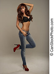 Sexy woman in jeans and red shoes