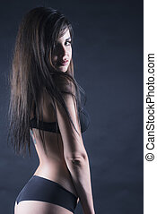 Sexy woman in ligerie - Portrait of a sexy woman with black...