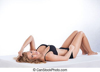 Sexy woman in lingerie lying on her back