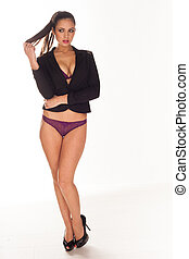 Sexy woman in purple lingerie covering her body with black blazer