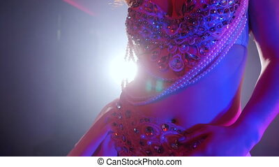 Sexy woman in rhinestones costume with shining stones....
