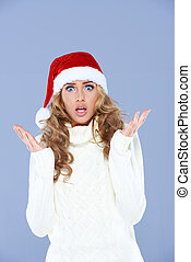 Sexy woman in Santa hat with hands raised