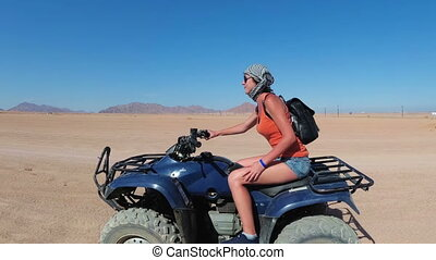 Sexy Woman is Riding a Quad Bike in the Desert of Egypt....