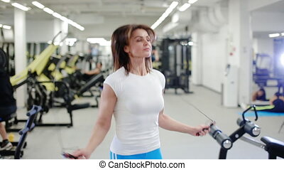 sexy woman jumping with a rope in the gym - sexy woman...