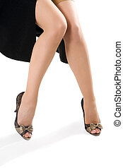 sexy woman legs in black shoes isolated on white