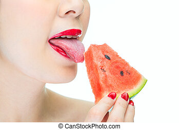 Sexy woman licking watermelon with red lips, desire