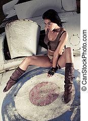 Sexy woman on aeroplane fuselage - Sexy woman sitting on an...