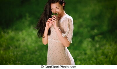 Sexy woman on nature gathering flowers - People Beauty and...