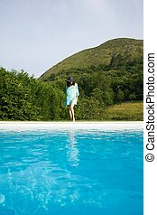 sexy woman on swimming pool border