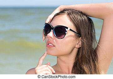 Sexy woman on the beach - Portrait of sexy woman wearing ...