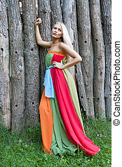 Sexy woman outdoor with nice colorful dress