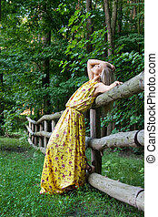 Sexy woman outdoor with nice yellow dress