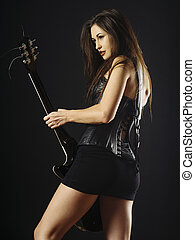 Sexy woman playing electric guitar
