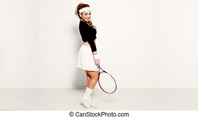 sexy woman playing tennis