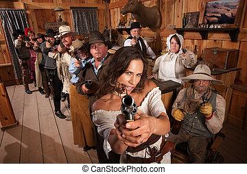 Sexy Woman Points Gun in Saloon