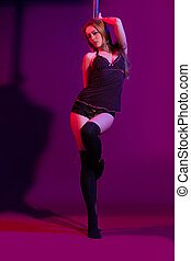 sexy woman pole dancer performing on stage - attractive sexy...