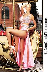 Sexy woman posing in elegant long dress.