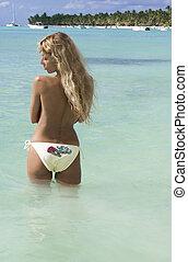 Sexy woman posing on the caribbean beach