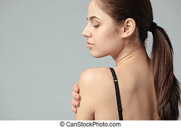Sexy woman posing with bare shoulder