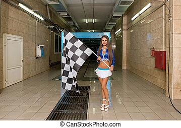 Sexy woman posing with checkered flag at car wash