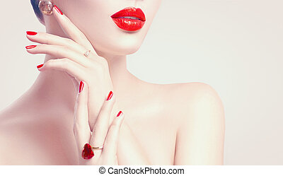 Sexy woman. Red lips and nails closeup. Manicure and makeup. Skincare concept