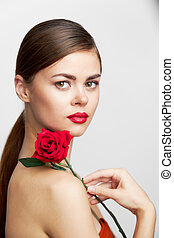 Sexy woman Red rose on the shoulder of the model