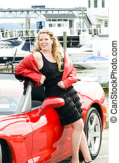 sexy woman red sports car at yacht club