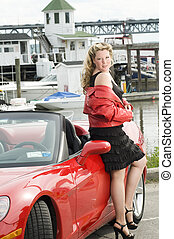 sexy woman red sports car