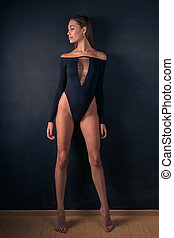 Sexy woman shows slender legs, posing for the camera