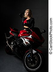 Sexy woman sitting on a motorcycle shot