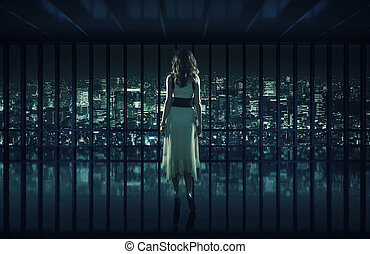 Sexy woman staring at night city - Sexy woman staring at ...
