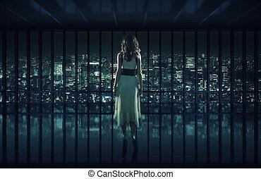Sexy woman staring at night city - Sexy woman staring at...