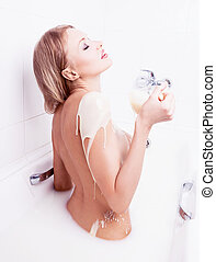 sexy woman - sexy young nude blond woman pouring condensed...