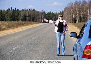 sexy woman stopping car girl hitchhiking on the road