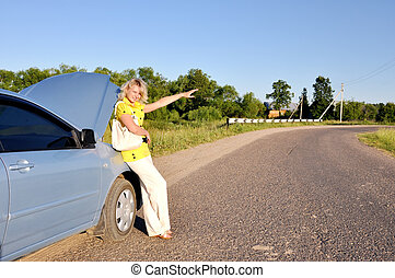 sexy woman stopping car on the road