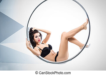 Sexy woman suspended from an aerial hoop - Sexy woman...