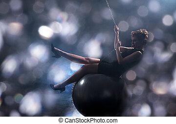 sexy woman swinging on ball