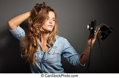 Sexy woman taking pictures with old camera