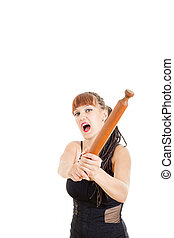 Sexy woman threatening with rolling pin