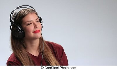 Sexy woman wearing headphones and listening music