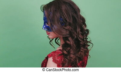 Sexy woman wearing masquerade mask at party