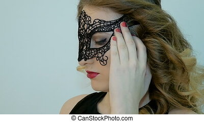 Sexy woman wearing masquerade mask at party. Slow motion.
