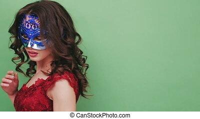 Sexy woman wearing masquerade mask at party