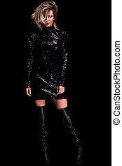sexy woman wearing shiny black dress standing