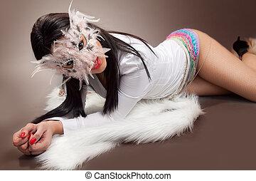 Sexy woman wearing venetian mask