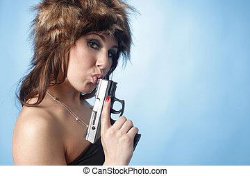 Sexy woman with a pistol