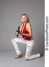 Sexy woman with an assault gun